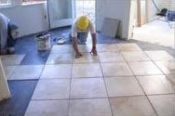 tiler laying tiles inside house